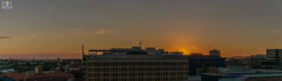 A partial panorama of the sunset over / behind the Mater Hospital in South Brisbane. Taken by Nikon D5300, Nikor 18-55mm Lens and stiched using Adobe Lightroom's Panorama function.